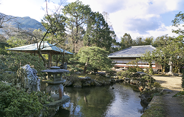 Alongside a garden pond in the shape of the kanji character for heart stand an elegant teahouse and arbor.