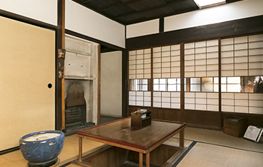 The living room where Hirose used to spend a lot of his time. The room has a fireplace, and the sliding doors have glass panes. The glass panes were placed at Hirose's eye level while seated so that he could observe the servants going to and fro.